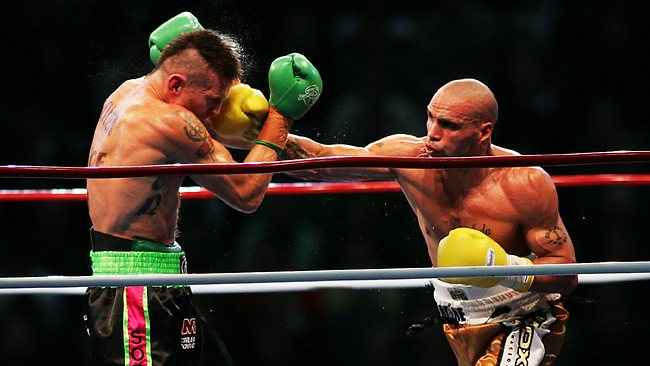 Anthony Mundine (Right)  lands a punch on rival Danny Green (Left)